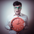 Funny businessman with wall clock — Stock Photo #23631679