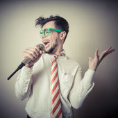 Funny stylish businessman singing — 图库照片
