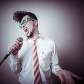 Funny stylish businessman singing — Stock Photo