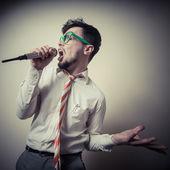 Funny stylish businessman singing — Stock Photo