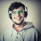 Boy with sweatshirt and headphones — Stock Photo