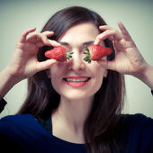Beautiful woman with strawberries on eyes — Stock Photo