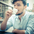 Stylish mdrinking coffee at bar — Stock Photo #24333305
