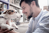 Stylish man with jack russell — Stock Photo