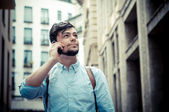 Stylish man in the street at the phone — Stock Photo
