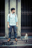 Stylish man in the street with a jack russel — Stock Photo