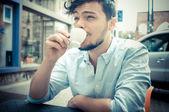 Stylish man drinking a coffee at the bar — Stock Photo
