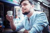 Stylish man drinking a coffee at the bar — Stock Photo