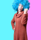 Beautiful girl with curly blue wig and turtleneck — Stock Photo