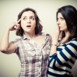 Stock Photo: Two young women thinking