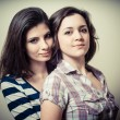 Two hugging young women — Stock Photo