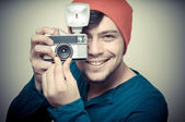 Young stylish man holding old camera — Stock Photo