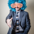 Funny businessman with big orange glasses and blue wig — Stockfoto