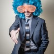 Funny businessman with big orange glasses and blue wig — ストック写真