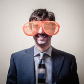 Funny businessman with big orange glasses — Stock Photo