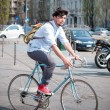 Hipster young man on bike — Stok fotoğraf
