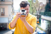 Hipster young man with polaroid — Stock Photo