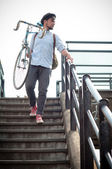 Hipster young man on bike — Stock Photo