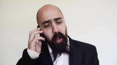 Funny elegant bearded man on the phone on vignetting background — Stock Video
