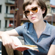 Young beautiful hipster woman reading book — ストック写真