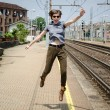 Young beautiful hipster woman jumping — Stock Photo