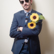 Elegant man with daisies — Foto de Stock