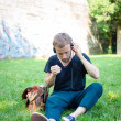 Hipster modern stylish blonde man listening music in park — Stock Photo #26995939