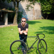Hipster modern stylish blonde man with bike — Stock Photo #26996335