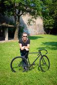 Hipster modern stylish blonde man with bike — Stock Photo