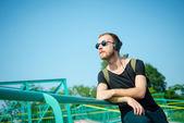Hipster modern stylish blonde man listening music — Stock Photo
