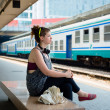 Beautiful stylish modern young woman waiting train — Stock Photo