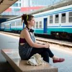 Beautiful stylish modern young woman waiting train — Stock Photo #27120275