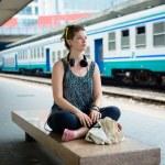 Beautiful stylish modern young woman waiting train — Stock Photo #27120279