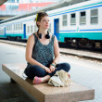 Beautiful stylish modern young woman waiting train — Stock Photo #27120287