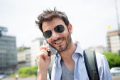 Man in the street on the phone — Stock Photo