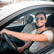 Stylish man driving car — Stock Photo