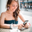 Young beautiful woman listening to music — Stock Photo