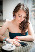 Young beautiful woman on the phone — Stock Photo