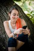 Beautiful woman fitness relaxing listening music — Stock Photo