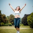 Beautiful woman fitness jumping — Stock Photo