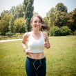 Beautiful woman fitness running — Stock Photo