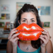 Beautiful woman with big mouth smiling — Stock Photo