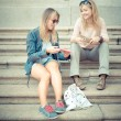 Two beautiful blonde women talking — Stock Photo #31409823