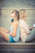 Two beautiful blonde woman relaxing — Stok fotoğraf