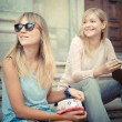 Two beautiful blonde women talking — Stock Photo #31410727