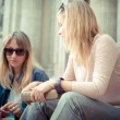 Two beautiful blonde women talking — Stock Photo #31410743