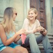 Two beautiful blonde women talking — Stock Photo #31410747