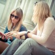 Two beautiful blonde women talking — Stock Photo #31410821