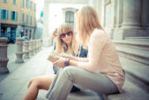 Two beautiful blonde women talking — Stock Photo