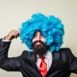 Crazy funny bearded man with blue wig — Stock Photo